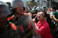Anti-Japanese protesters in Shenzhen, China are confronted by police as they demonstrate over the disputed Diaoyu Islands, September 16, 2012