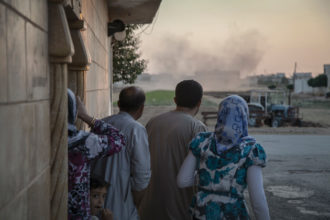 Residents of Tall Rifat, a small town north of Aleppo, after a Syrian army helicopter launched rockets at a local school, July 12, 2012