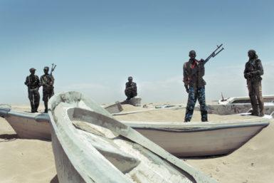 Pirate militiamen at a port in Hobyo, Somalia, August 2010