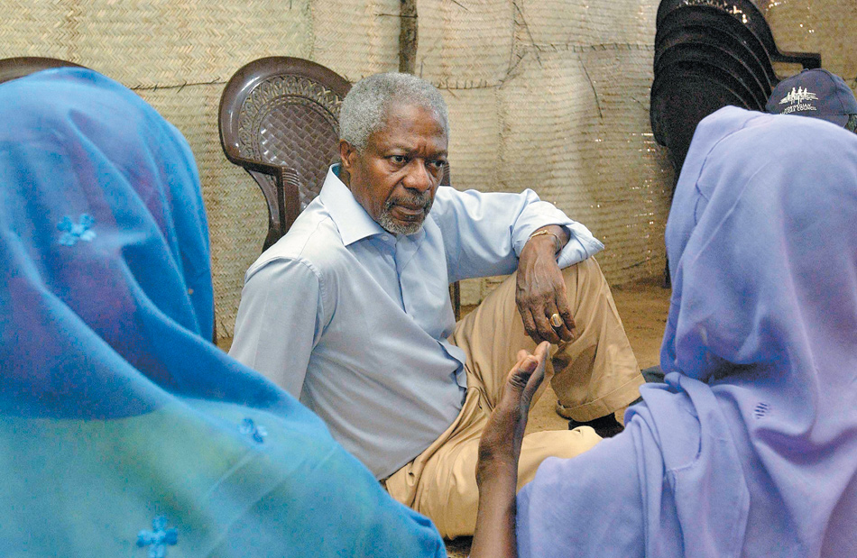 Kofi Annan in Darfur, listening to two women who had suffered at the hands of the Janjaweed militia, May 2005