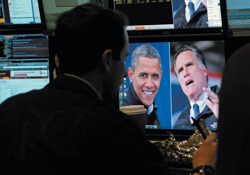 A trader on the floor of the New York Stock Exchange the morning after the presidential election, November 7, 2012