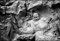PLA soldiers on a Yuan Dynasty statue of a Maitraya, West Lake near Hangzhou, China, 1978