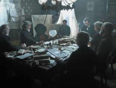 President Lincoln, played by Daniel Day-Lewis (third from right), meeting with his cabinet to discuss the planned attack on Fort Fisher, in Steven Spielberg's Lincoln. David Strathairn as Secretary of State William Seward is seated to the president's left.