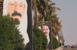 Portraits of King Abdullah when he was crown prince (left) and the late Prince Sultan (center), who was heir apparent when he died last year, on the outskirts of Riyadh, September 2003
