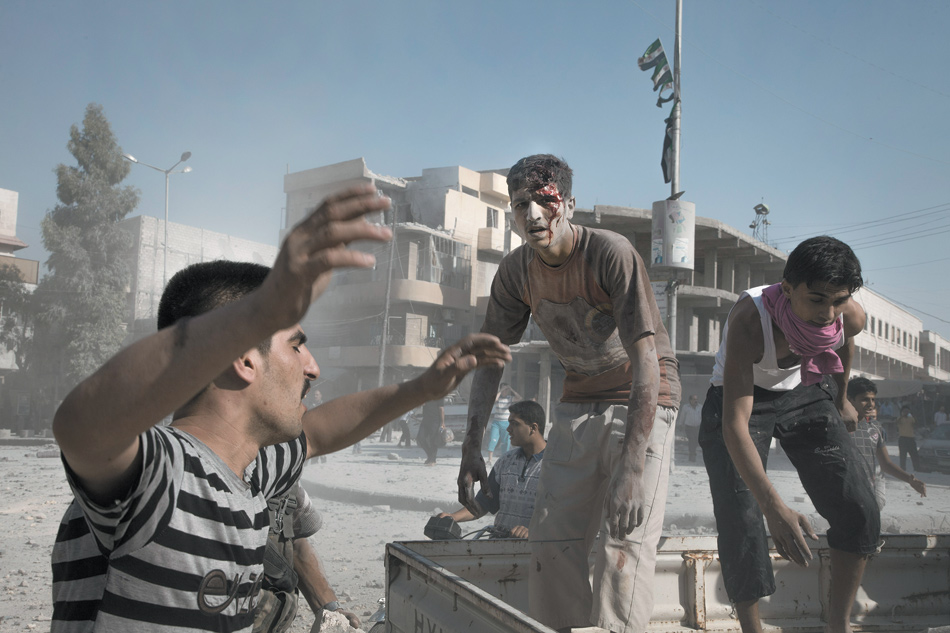 Central Aleppo, after a Syrian army plane dropped a bomb on a residential building, killing and wounding dozens of people, September 8, 2012