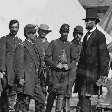 President Abraham Lincoln and General George McClellan (second from left) after the  Battle of Antietam, October 3, 1862