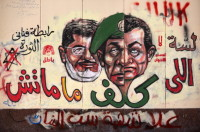 Graffiti outside Cairo's presidential palace showing the faces of Mohamed Morsi (left), former armed forces chief Field Marshal Mohammed Tantawi, and former president Hosni Mubarak, December 8, 2012
