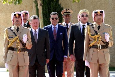 Jordan's King Abdullah II (center left) with Morocco's King Mohammed VI (center) and Bedouin honor guards, Amman, Jordan, October 18, 2012