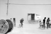 Syrians in a sandstorm at the Zaatari refugee camp, northern Jordan, August 31, 2012