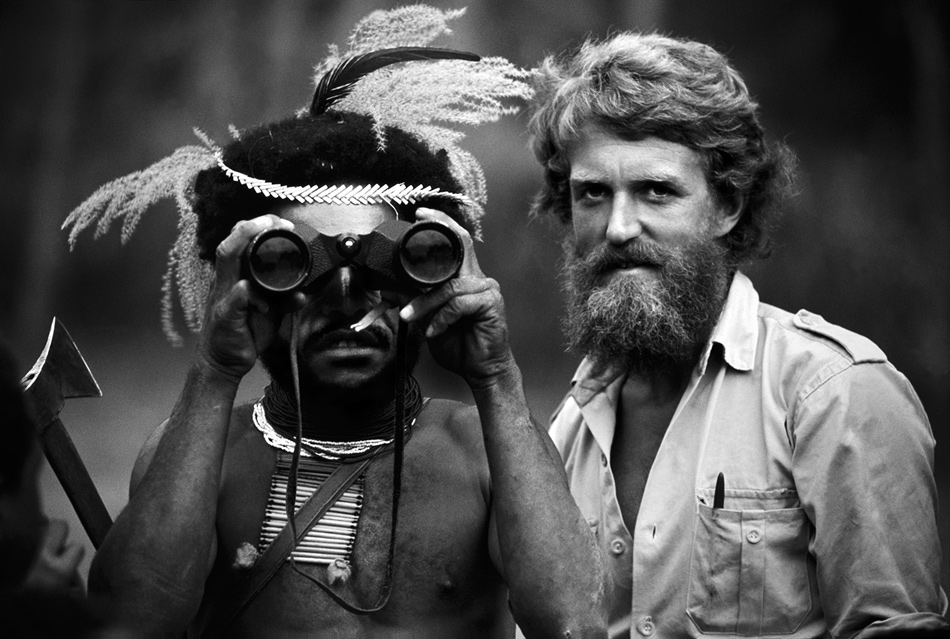 A warrior in Papua New Guinea looking through binoculars for the first time, 1973