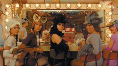 Kara Hayward (center) in Wes Anderson's Moonrise Kingdom, in a scene showing preparations for a production of Benjamin Britten's opera Noye's Fludde
