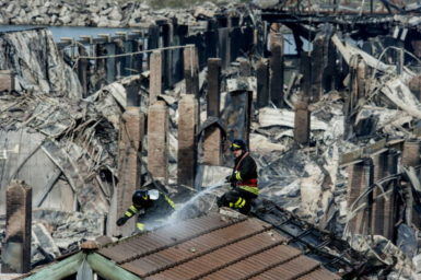 Firemen at the burned down City of Science museum, Naples, Italy, March 5, 2013
