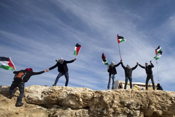 Palestinian flags Bab al Shams.jpg