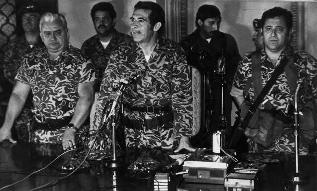 General Efraín Ríos Montt (center) announcing his military coup, Guatemala City, March 23, 1982
