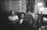 William S. Burroughs and Jack Kerouac, photographed by Allen Ginsberg in his East Village living room, 1953; from 'Beat Memories: The Photographs of Allen Ginsberg,' an exhibition organized by the National Gallery of Art and on view at NYU's Grey Art Gallery until April 6, 2013. The catalog includes an essay by Sarah Greenough and is published by the National Gallery and DelMonico Books/Prestel.