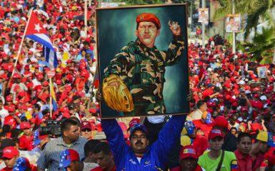 Nicolás Maduro campaigning with a painting of Hugo Chávez, Catia la mar, Venezuela, April 9, 2013