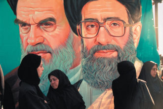 Portraits of Iran's supreme leaders, Ayatollahs Khomeini and Khamenei, Tehran, May 2001