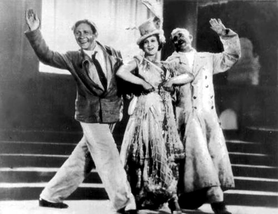 Leonid Utesov, left, in the Soviet film Merry Fellows, 1934