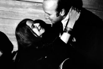 Janis Joplin and the music mogul Clive Davis at a party celebrating the signing of her band to Columbia Records, New York City, 1968