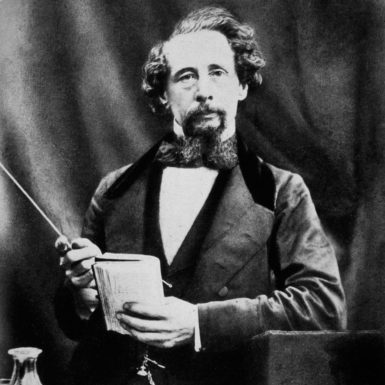 Charles Dickens, about to begin a public reading, 1858