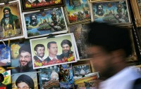 Posters of Iranian President Mahmoud Ahmadinejad, Syrian President Bashar Al-Assad, and Hezbollah leader Sheikh Hassan Nasrallah at the Sayyida Zainab shrine, Damascus, Syria, June 2006