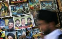 Posters of Iranian President Mahmoud Ahmadinejad, Syrian President Bashar Al-Assad, and Hezbollah leader Sheikh Hassan Nasrallah at the Sayyida Zainab shrine, Damascus, Syria, June 2006