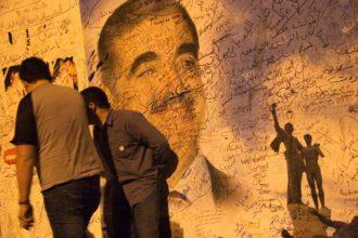 A graffiti covered image of slain prime minister Rafiq Hariri, Beirut, Lebanon, 2006