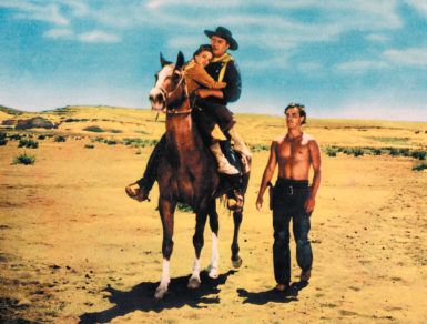 John Wayne as Ethan Edwards bringing back his niece Debbie Edwards (played by Natalie Wood, and based on the figure of Cynthia Ann Parker) to her white family after her abduction by the Comanches, with her adopted brother Martin Pawley (played by Jeffrey Hunter), near the end of John Ford's The Searchers, 1956