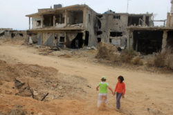 Children in Qusayr, Syria, after Hezbollah recaptured the town for the regime, June 8, 2013