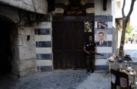 A soldier standing guard in the old city of Damascus, June 21, 2013