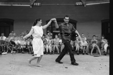 The artist Otto Mühl, dancing with a member of his Friedrichshof commune, June 1, 1989