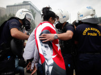 Police detaining a woman during protests at Kizilay square in central Ankara, June 16, 2013