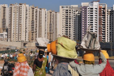 Laborers in front of an apartment complex for technology workers, Hyderabad, India, March 3, 2012