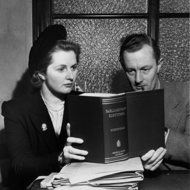 Margaret Thatcher studying a parliamentary reference book with a colleague during her first political campaign, for the seat of Dartford, Kent, January 1950