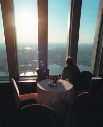 A diner looking across the Hudson River and New Jersey from Windows on the World, the restaurant at the top of the north tower of the World Trade Center, June 1996