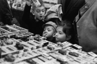 Children buying toy cars, Paris, 1967; photograph by Henri Cartier-Bresson