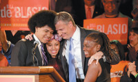 Bill de Blasio with his son Dante, daughter Chiara, and wife Chirlane after addressing supporters on the night of New York City's primary election, September 16, 2013