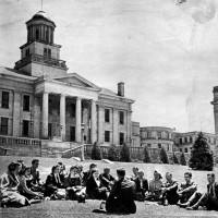 A writers' workshop on the lawn in front of the Old Capitol building at the University of Iowa, Iowa City, 1940s