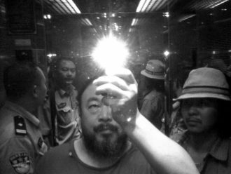 Photograph by the Chinese artist and activist Ai Weiwei (middle) that he took in a mirrored elevator with two police officers and the Chinese artist and musician Zouxiao Zuzhou (right), Chengdu, China, 2009