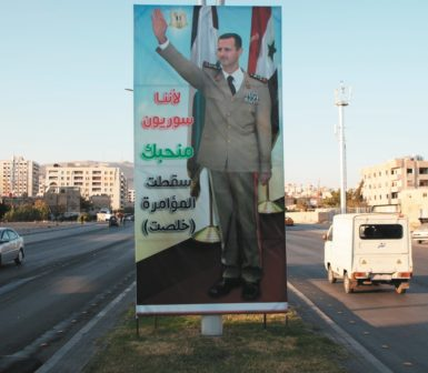 A pro-Assad poster in Damascus, Syria, September 29, 2013. The text reads: 'Because we are Syrians, we love you. The conspiracy failed.'