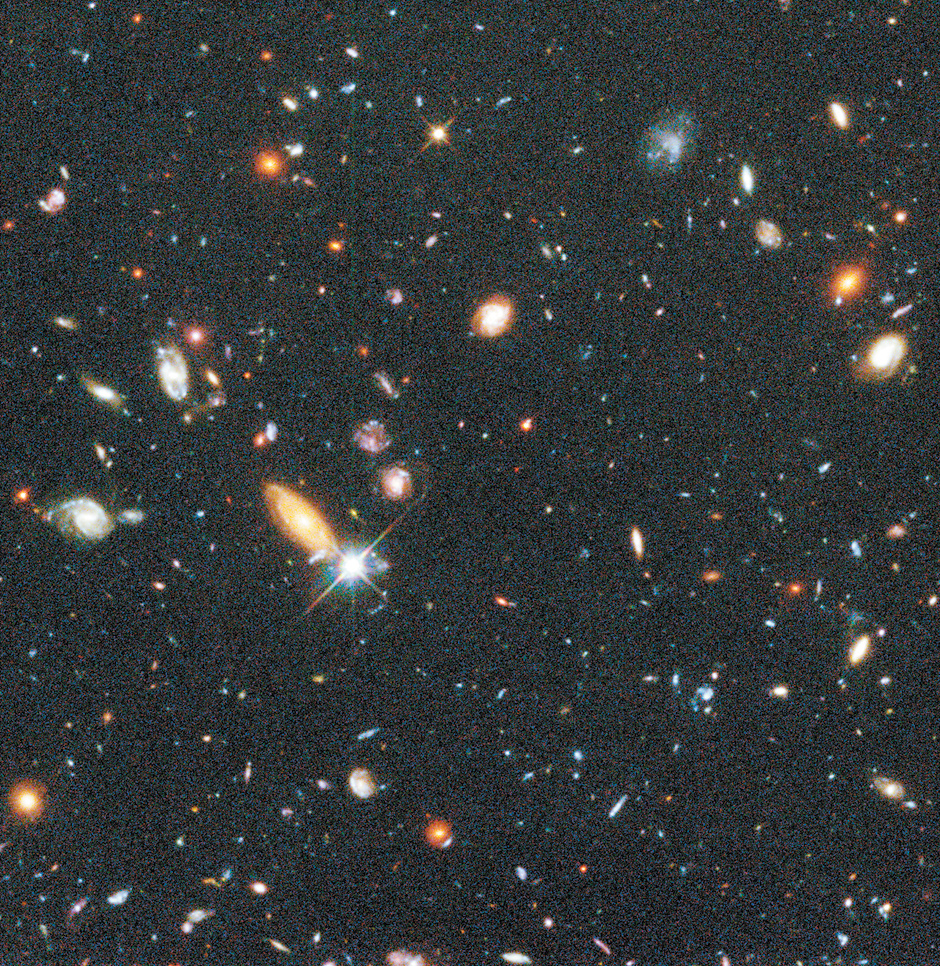 A view of about a quarter of the 'Hubble Deep Field,' a tiny patch of sky about one thirtieth the diameter of the full moon, photographed in December 1995 by the Hubble Space Telescope with an exposure time of ten days, showing the 'deepest-ever' view of the universe. The galaxies in this picture are so far away that their light has been traveling to us for most of the history of the universe.