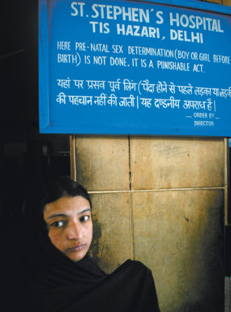 A sign saying that pre-natal sex ­determination is illegal, St. Stephen's ­Hospital, New Delhi, 2005