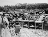A Chinese man accused of being a 'landlord' facing a People's Tribunal just before being executed, Guangdong, China, July 1952