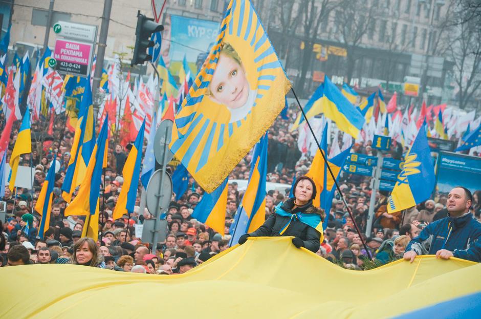 Antigovernment protesters with a flag showing imprisoned former prime minister Yulia Tymoshenko, Kiev, Ukraine, November 24, 2013