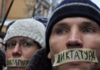 Ukrainians protesting anti-democracy laws with the word