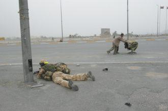 An Allied soldier and Iraqi looters, Basra, Iraq, April 7, 2003