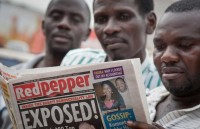 People reading a list of alleged gays in Red Pepper, Kampala, Uganda, February 25, 2014