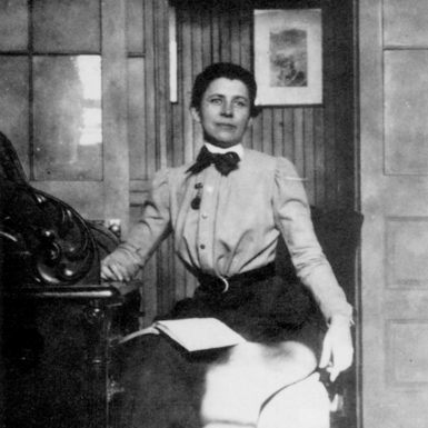 Ida Tarbell at her desk at McClure's magazine, New York City, 1894