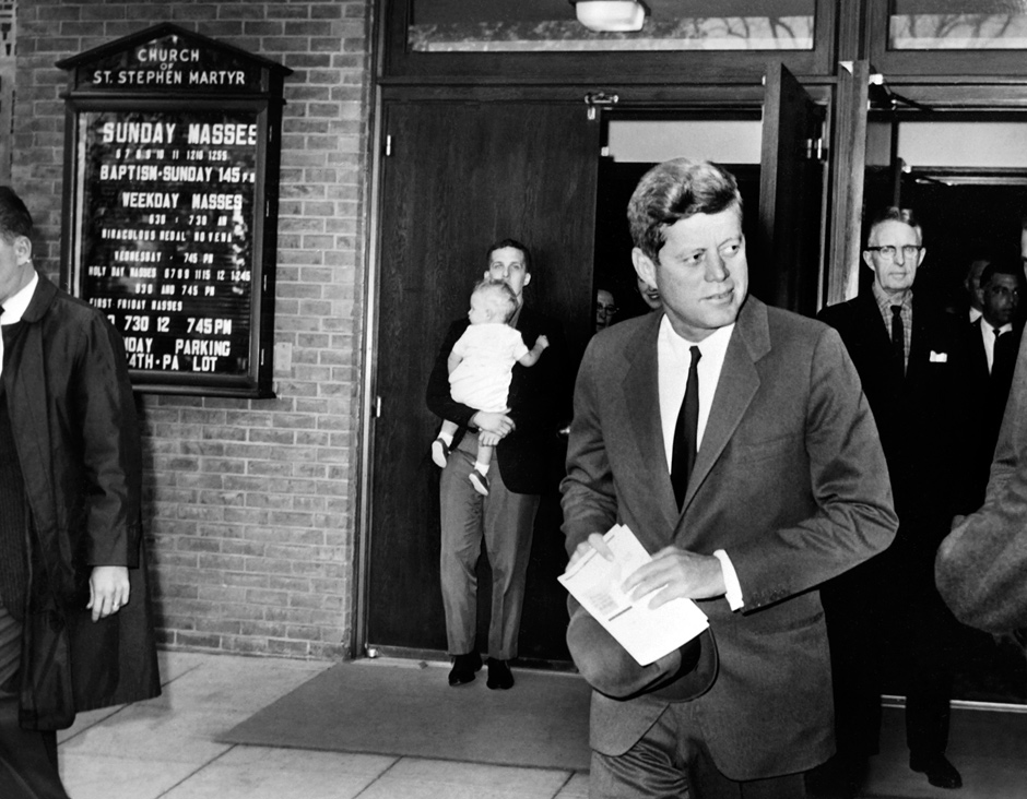 President Kennedy leaving St. Stephen Martyr Church in Washington, D.C., after attending Mass on the day Soviet leader Nikita Khrushchev announced the withdrawal of Soviet missiles from Cuba, October 28, 1962