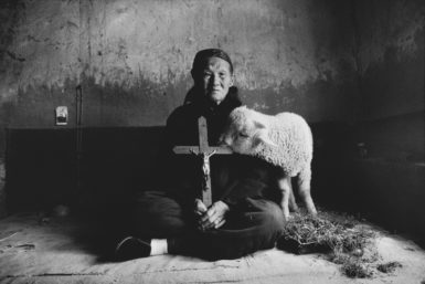 Han Ying Fang, a fifth-generation Catholic, Shanxi province, China, 1992. The crucifix she is holding was hidden in the ceiling of her house during the Cultural Revolution.